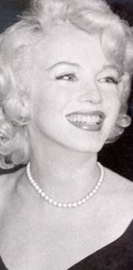 Marilyn Monroe wearing a pearl necklace and a black dress